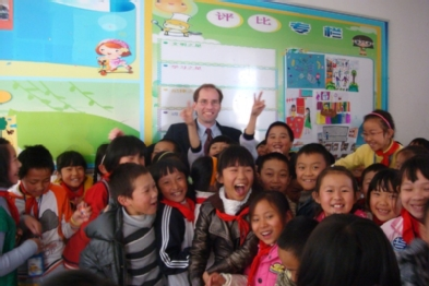 Chris Gareis, Associate Dean for Teacher Education and Professional Services, visiting a Grade 4 classroom in Kunming, China.  The teacher described him as the first Westerner that the children had seen in person.