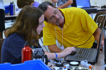 A student and a STEM professional collaborate on a project during the First Annual Hampton Roads STEM Summer Academy  at Corporate Landing Middle School in Virginia Beach. Photo Credit: Karen Hogue