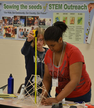 Students build towers that will be put the test to see how much weight it can bear at the First Annual Hampton Roads STEM Summer Academy. Photo Credit: Karen Hogue