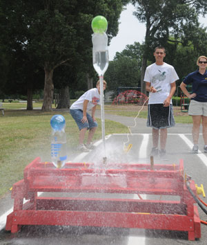 Students demonstrate a rocket launch during the 2010 Dahlgren Summer Academy.  Photo Credit: Karen Hogue